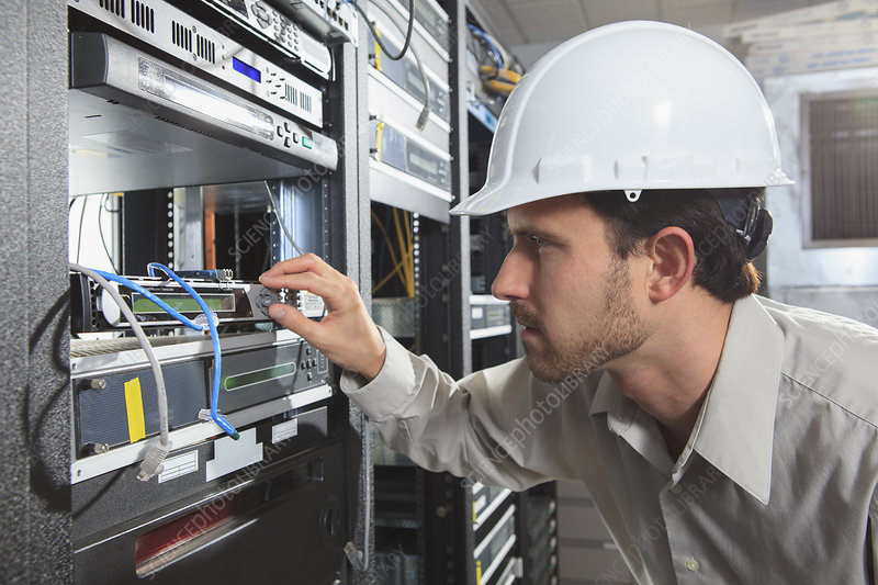Network engineer working in a server room