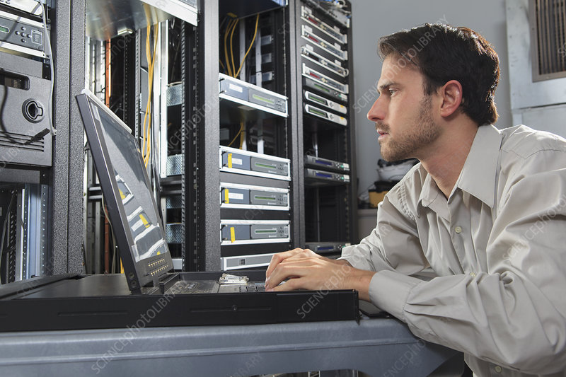 Network engineer in cable server room