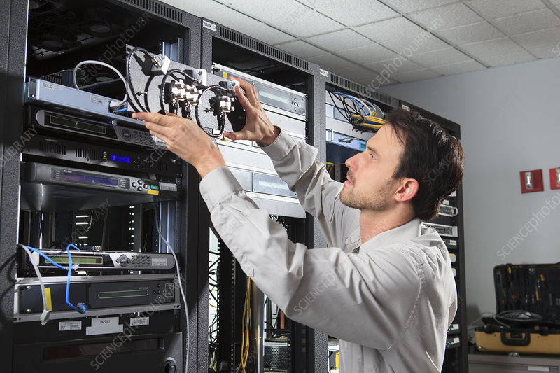 Network engineer putting switches