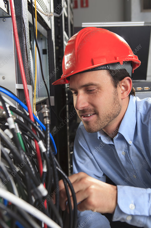 Network engineer examining configuration