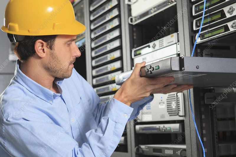 Network engineer installing equipment