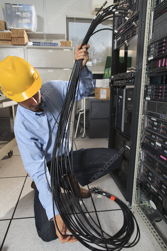 Network engineer preparing cabling