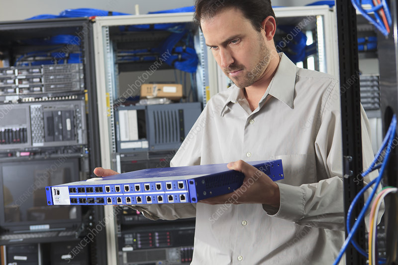 Network engineer examining switch