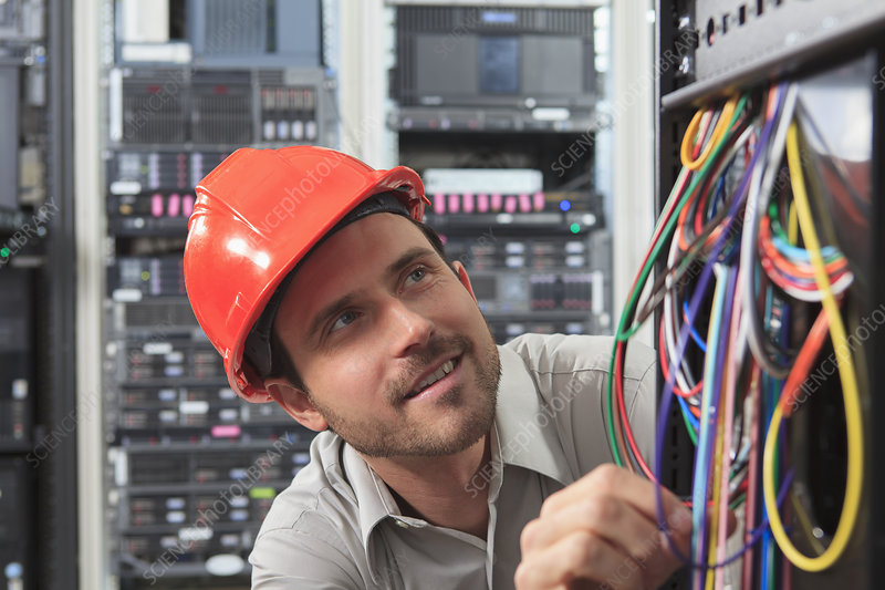 Network engineer examining cable