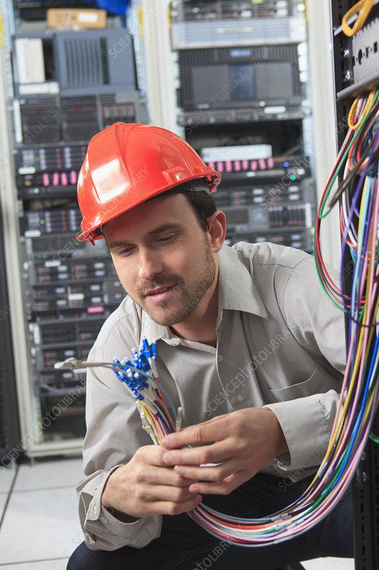 Network engineer preparing fiber cables - Stock Image ...