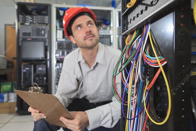 Network engineer reviewing control system