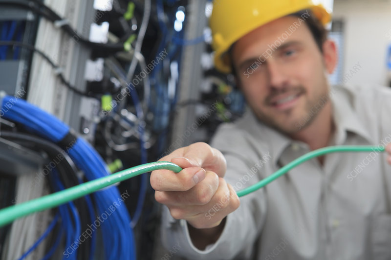 Network engineer pulling cable
