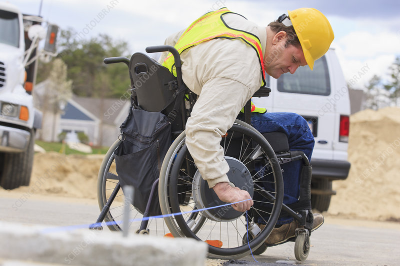 Construction supervisor in wheelchair