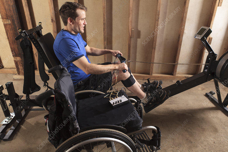 Man in wheelchair with muscle stimulator