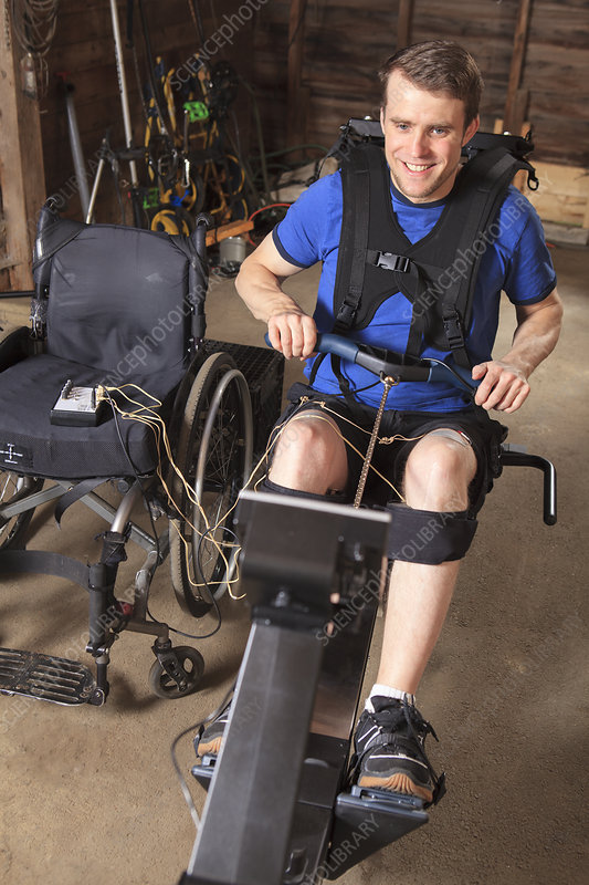 Man in wheelchair using rowing machine