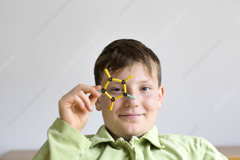 Boy holding a molecular model