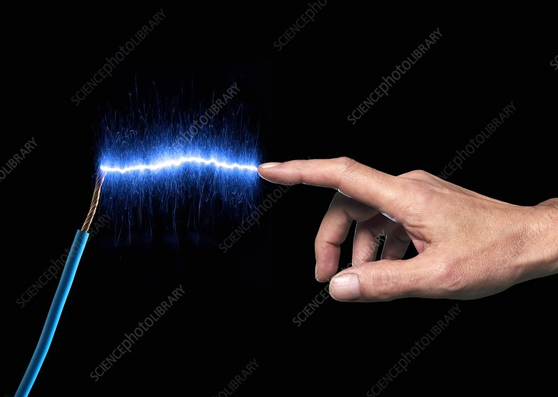 Finger touching blue sparks
