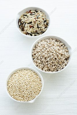 Barley, rice and quinoa in bowls