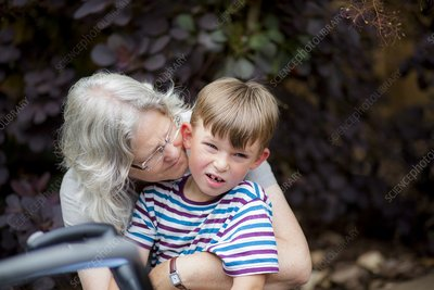 Grandmother hugging grandson