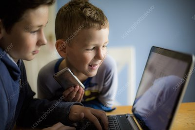 Boys using laptop