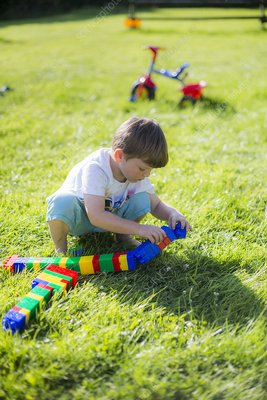 Boy playing with plastic bricks