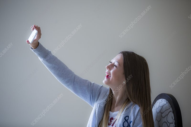 Girl taking selfie on smartphone