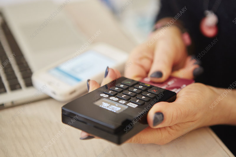 Woman's hands on credit card reader