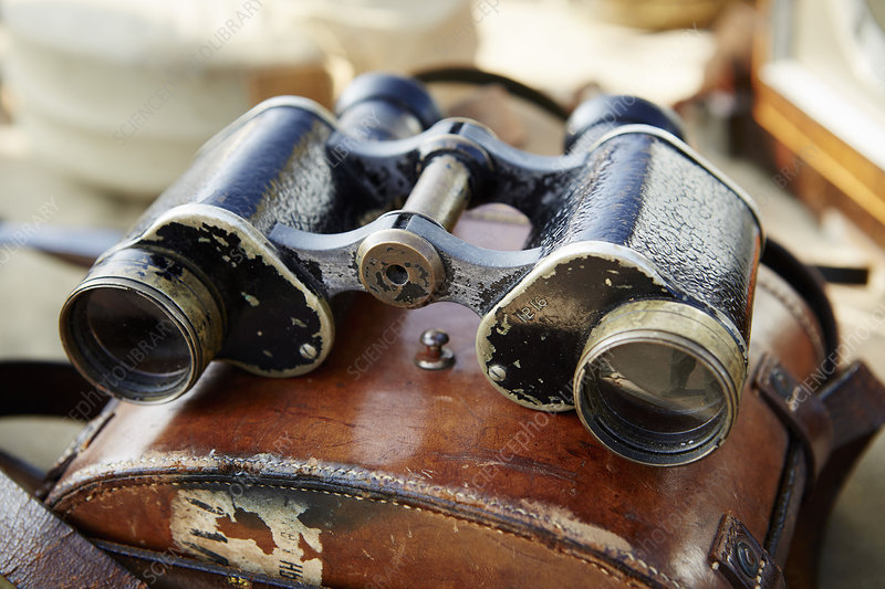 Vintage binoculars with worn leather case