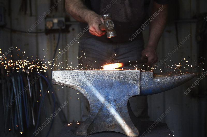 A blacksmith shaping a hot piece of iron