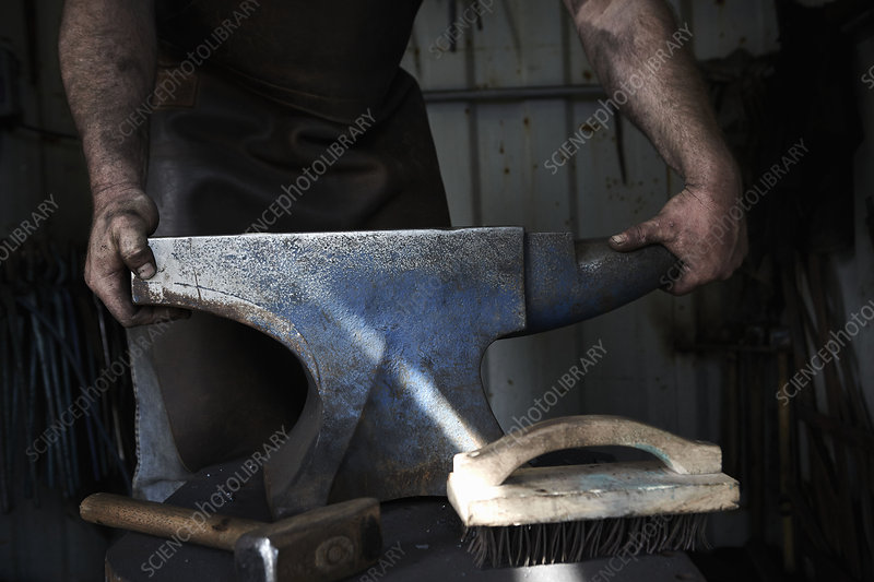 Blacksmith standing at an anvil