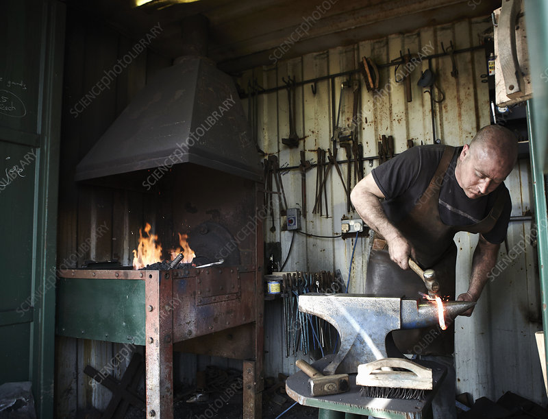 Blacksmith shaping a hot piece of iron