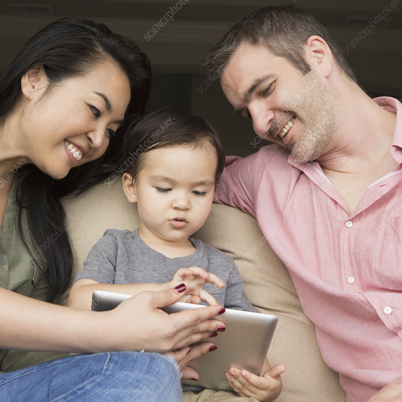Parents and boy sharing a digital tablet