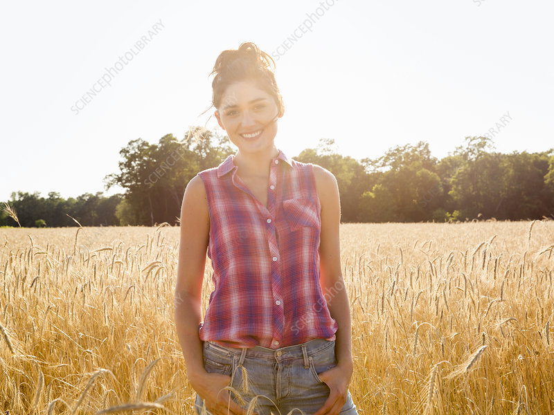 A young woman standing in a field