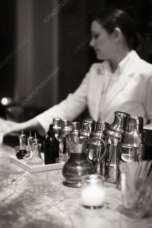 Young woman mixing a cocktail