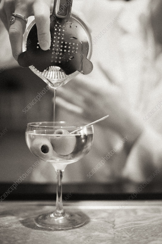 A woman mixing a cocktail, a mixologist