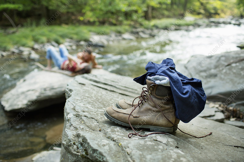 Jeans and boots on a rock