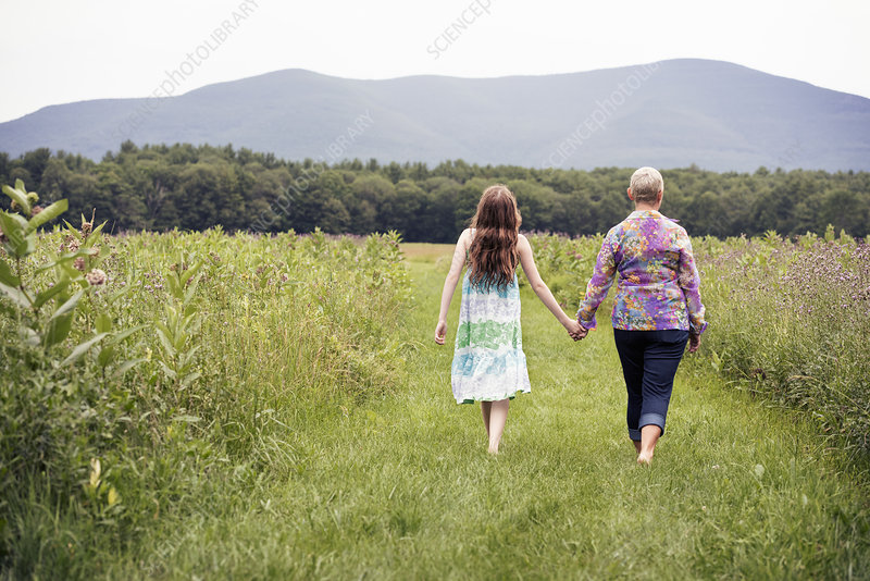 Woman and a young girl in a meadow