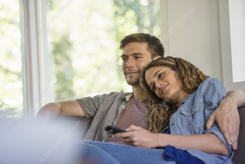 A couple watching a screen
