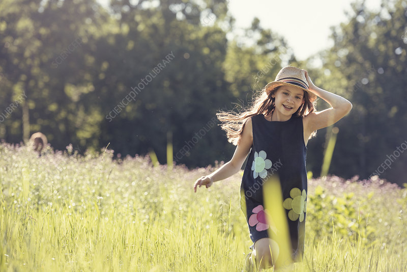 A girl in a sun hat in summer