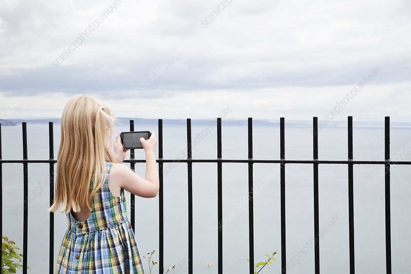 A girl taking picture with a smart phone