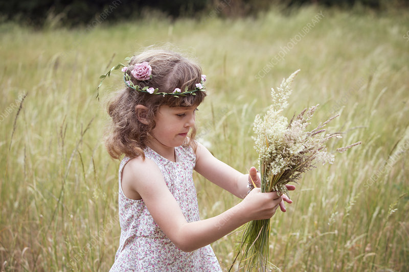 Young girl picking wild flowers