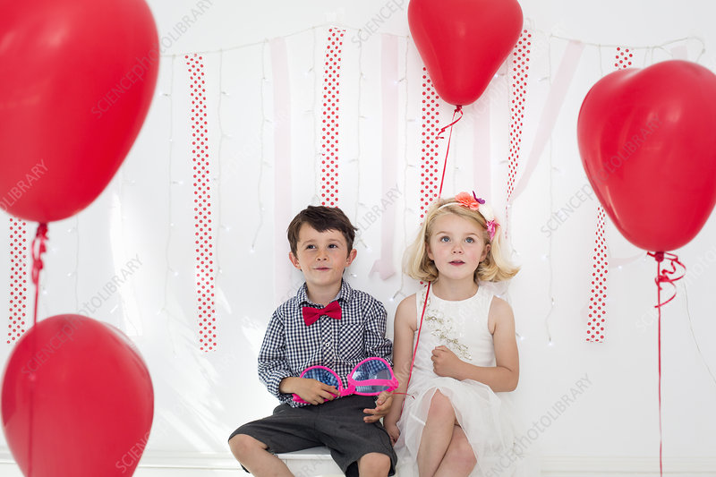Young boy and girl posing for a picture