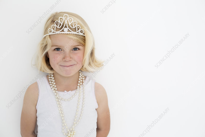 Girl wearing a tiara and a pearl necklace