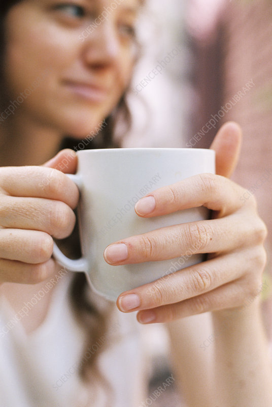 Close up of a woman holding a teacup
