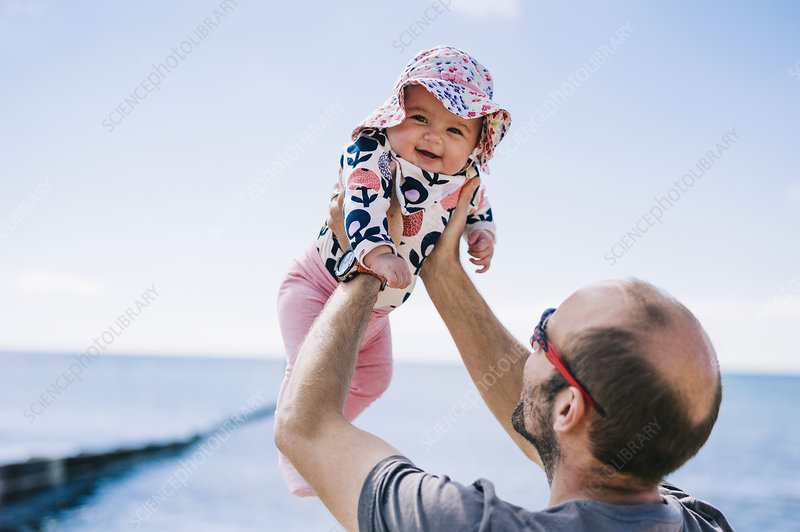 A father lifting his daughter in the air