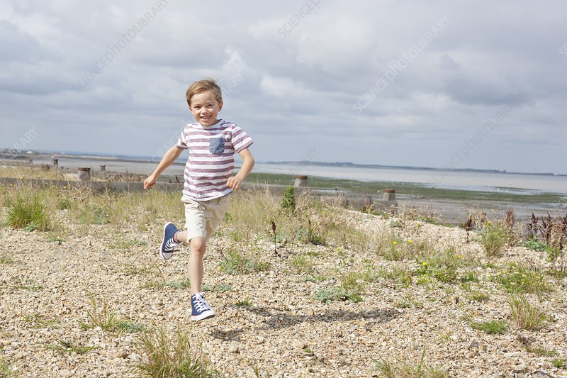 Boy running on the beach