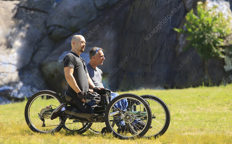 Two men with spinal cord injuries