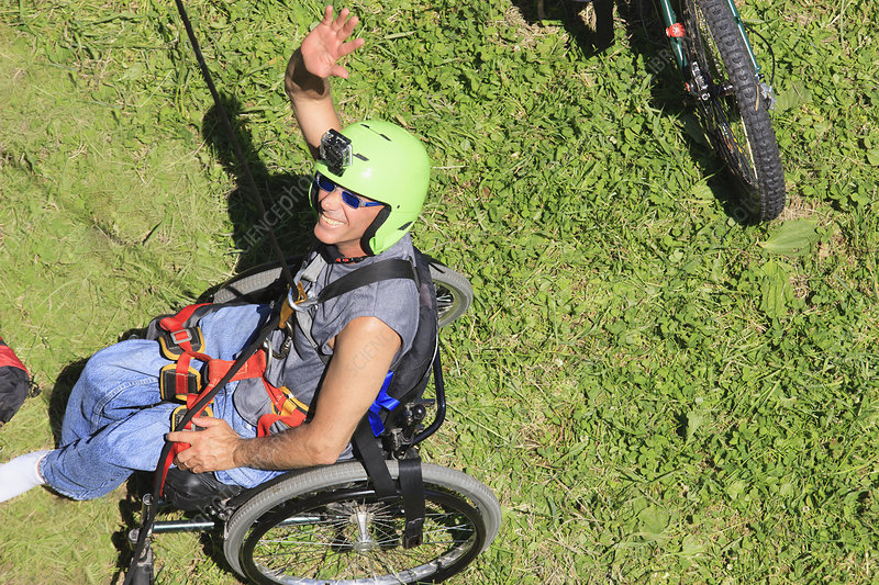 Man with spinal cord injury rock climbing