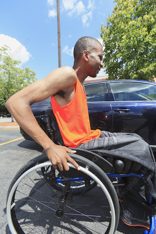 Man in wheelchair entering a car
