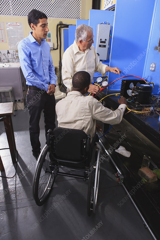 Instructor with student in wheelchair