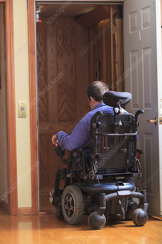 Disabled man entering a home elevator