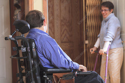 Disabled couple entering a home elevator