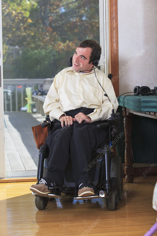 Man in wheelchair using hands free kit