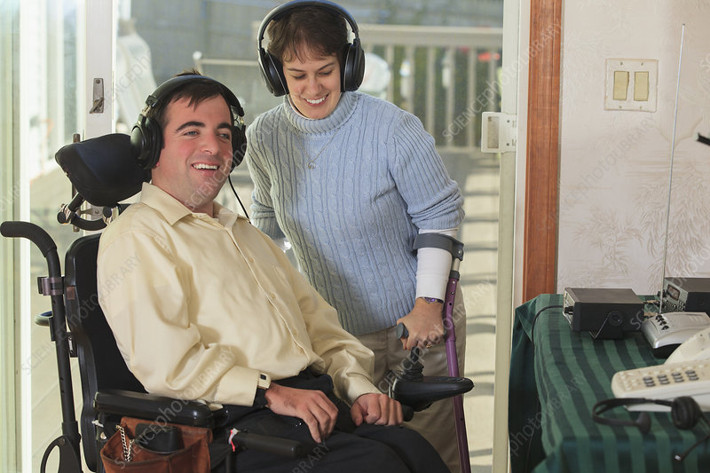 Disabled couple using headphones