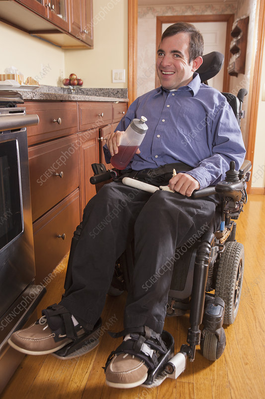 Disabled man in his kitchen